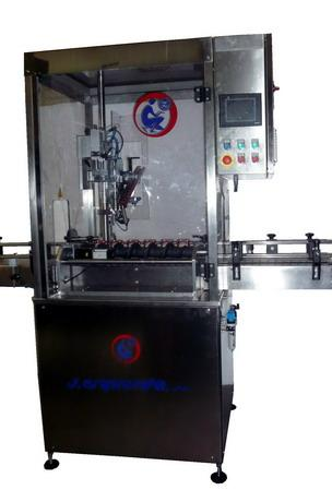 Linear capping machine for metallic cans